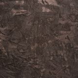 Creased brown cloth material fragment Royalty Free Stock Images