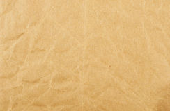 Creased brown paper. Old creased brown paper as a background and texture stock images
