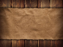 Creased fabric on wooden background Stock Photography