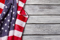 Creased flag of US. Stock Photos