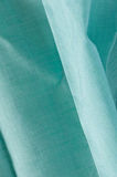 Creased green cotton cloth Stock Images