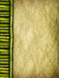 Creased handmade paper sheet and bamboo sticks Stock Images