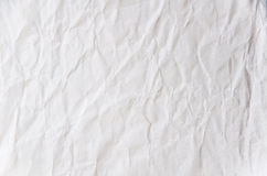 Creased paper. A creased neutral paper surface Stock Images