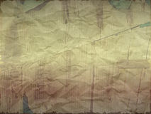 Creased paper with wood effect in light shade. Torn edges Stock Photos