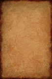 Creased Parchment Texture. Creased parchment paper background texture with dark burned effect around border Stock Image