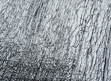Creased silver aluminium foil Stock Photo