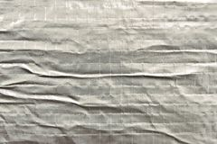 Creased, silver background Stock Photos
