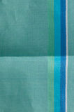 Creased striped cotton fabric. Detail of creased and unfolded light blue green turquoise fine cotton fabric Stock Images