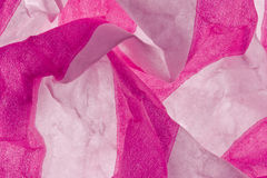 tissue paper background. A close-up of creased pink and white striped tissue paper Stock Photos