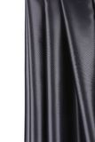 Creases in black fabric. Close up. Whole background Royalty Free Stock Images