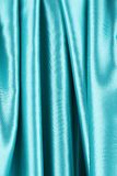 Creases in blue fabric. Close up. Whole background Stock Images