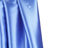Creases in blue fabric. Stock Photo