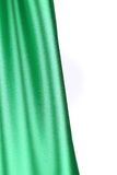 Creases in green fabric. Close up. Stock Image