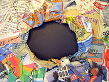 Creasy newspaper. Colorful creasy newspaper with hole Stock Photos