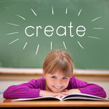 Create against cute pupil sitting at desk Royalty Free Stock Photography