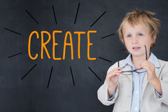 Create against schoolboy and blackboard Stock Photography