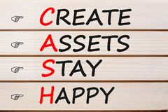 Create Assets Stay Happy CASH. CREATE ASSETS STAY HAPPY words with CASH written on wood wall decor. Acronym concept royalty free stock photography