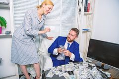Create bank account. Credit loan and cash concept. Businessman with cash bank client. Office manager hold bank card. Man. Business owner sit office pile of royalty free stock images