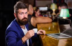 Create content web blog. Manager create post enjoy coffee. Hipster freelancer work online drinking coffee. Man bearded. Businessman sit bar counter with laptop stock image
