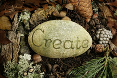 Create etched on a stone on the forest floor stock photos