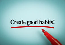 Create Good Habits. Text Create Good Habits with red underline on the light blue background Royalty Free Stock Image