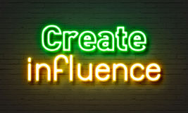 Create influence neon sign on brick wall background. Create influence neon sign on brick wall background Stock Images