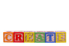 Create Isolated. Create is spelled in letter blocks isolated with copy space Royalty Free Stock Photo