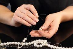 Create jewelry, threading beads Royalty Free Stock Image