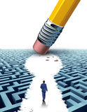 Create The Key. Leadership Solutions with a businessman walking through a complicated maze opened up by a pencil eraser shaped as a keyhole symbol as a business Royalty Free Stock Photo