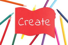 Create message on red wood sign with colored watercolor pencils royalty free stock photography