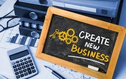 Create new business handwritten on blackboard Royalty Free Stock Images