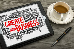 Create new business with related word cloud handwritten on table Royalty Free Stock Photos