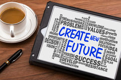 Create new future with related word cloud hand drawing on tablet Stock Image