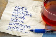 Create original, useful, informative content. Create original, persuasive, natural, useful, informative content - writing content advice - handwriting on napkin Stock Image