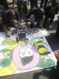 Create poster. Teen competition to create a poster on the street in the city of Solo, Central Java, Indonesia Stock Photos