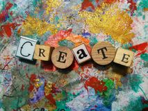 Create!. Rubber stamp letters spelling the word & x27;Create& x27; on a painted background Stock Photography