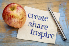 Create, share inspire motivational words on napkin Royalty Free Stock Image