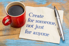 Create for someone. Not just anyone - handwriting on a napkin with a cup of coffee Stock Images