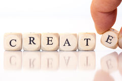 Create, spelled with dice letters Royalty Free Stock Photos