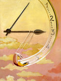 Create time. A trapeze hanging from the hands draws a clock in the sunset Stock Photos