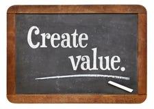 Create value on blackboard. Create value - advice or reminder on a vintage slate blackboard Royalty Free Stock Photo
