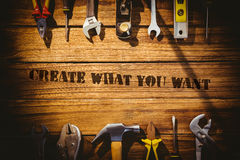 Create what you want against desk with tools. The word create what you want against desk with tools Royalty Free Stock Images