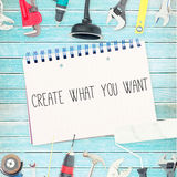 Create what you want against tools and notepad on wooden background. The word create what you want against tools and notepad on wooden background Royalty Free Stock Photography