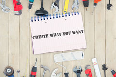 Create what you want against tools and notepad on wooden background. The word create what you want against tools and notepad on wooden background Stock Photos