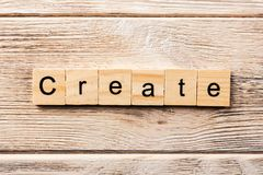 Create word written on wood block. create text on table, concept stock photography