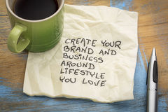 Create your brand and business. Around lifestyle you love - handwriting on a napkin with a cup of coffee Stock Photos
