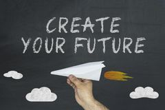 Create your future concept with flying airplane on chalkboard.  royalty free stock images