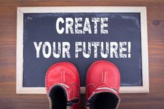 Create your future. kid shoes on on chalkboard and wooden backgroundr royalty free stock photography