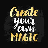 Create Your Own Magic poster. With hand drawn brush lettering. Vector modern calligraphy in retro style, gold and black colors. Typography design, t-shirt print Royalty Free Stock Photography