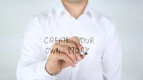 Create Your Own Story, Man Writing on Glass. High quality stock photo